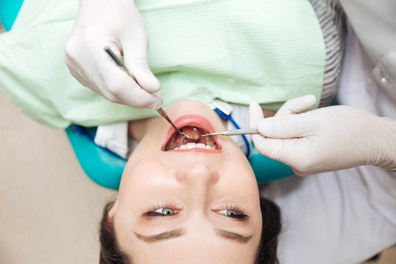 male patient undergoing scaling and polishing treatment at NoFrills Dental