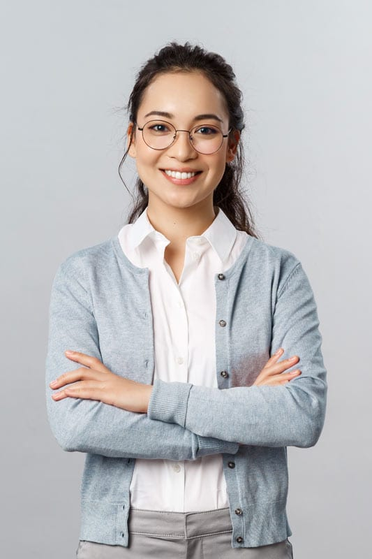 Lady wearing her retainers after completing her Invisalign treatment in Singapore