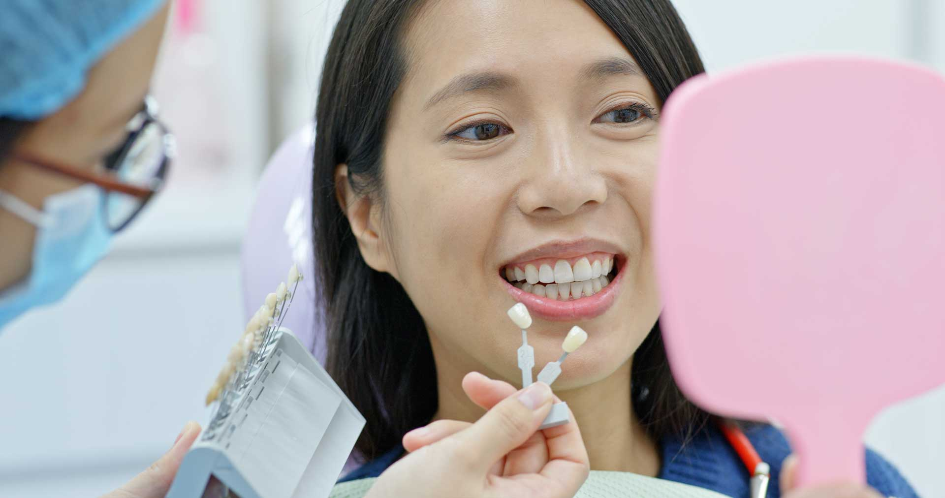 asian woman getting her teeth professionally whitened at a dental clinic in Singapore