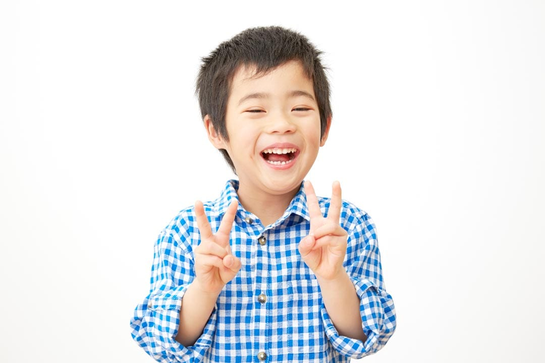 Happy little boy enjoying his Invisalign first treatment in Singapore