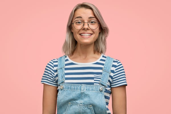 Lady wearing braces and smiling in Singapore